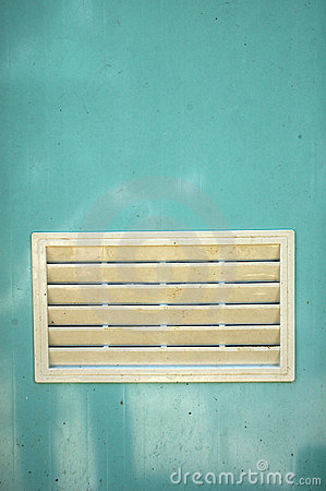 A dirty white ventilation window