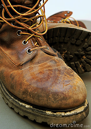 Dirty work boots with mud and scratches