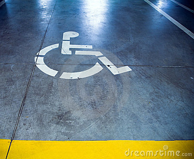 Disability sign in parking garage, underground