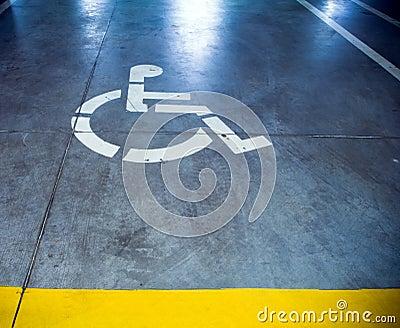 Disability sign in parking garage, underground