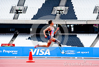 Disabled athlete running at London 2012 stadium Editorial Stock Image
