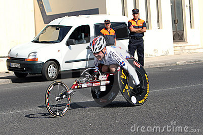 Disabled athlete in a sport wheelchair in marathon Editorial Stock Photo