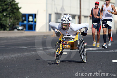 Disabled athlete in a sport wheelchair in marathon Editorial Photo