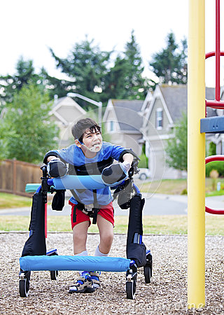 Disabled boy in walker at inaccessible pla