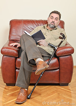 Disabled businessman reading