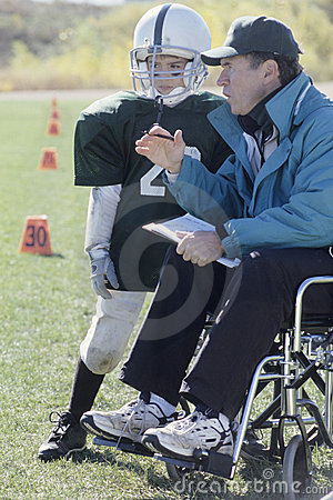 Free Disabled Coach And Junior Football Player Royalty Free Stock Image - 6272326