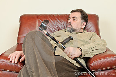 Disabled man in leather armchair