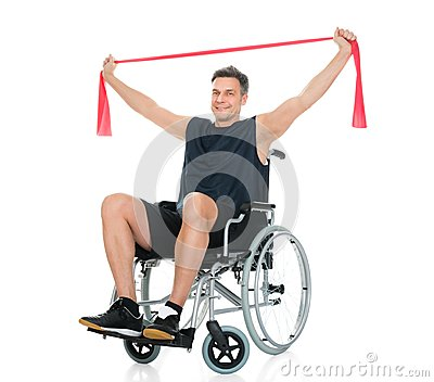 Disabled Man On Wheelchair Exercising With Resistance Band Stock Photo ...