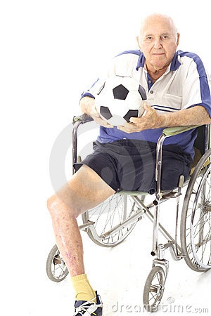 Disabled man in wheelchair with soccer ball
