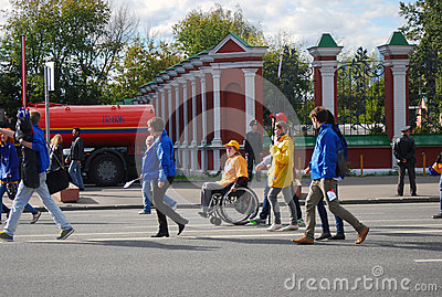 Disabled person in a wheelchair at students parade Editorial Stock Image