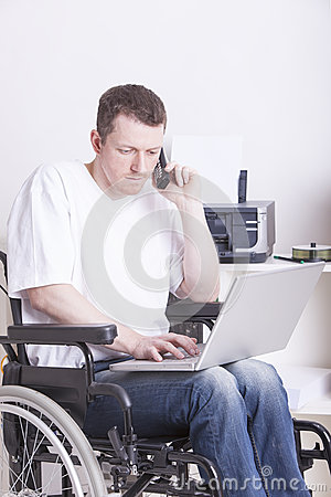 Disabled young man at the office