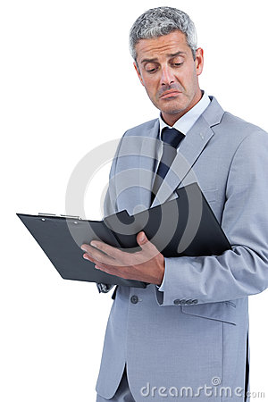 Disappointed businessman holding clipboard
