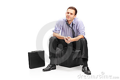 Disappointed businessman sitting