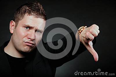 Disappointed man signaling thumb down
