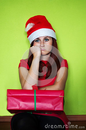 disappointed woman holding present