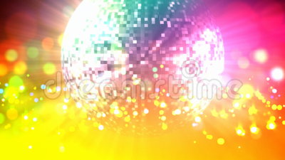 Disco ball loop. Retro mirrored disco ball, rotating in the spotlight and the magic colored particles around