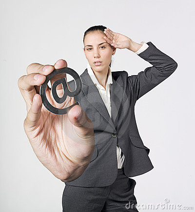 Discomfort businesswoman holding a @ symbol