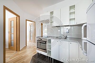 Dise o interior de la cocina moderna peque a blanca foto - Cocinas de diseno blancas ...
