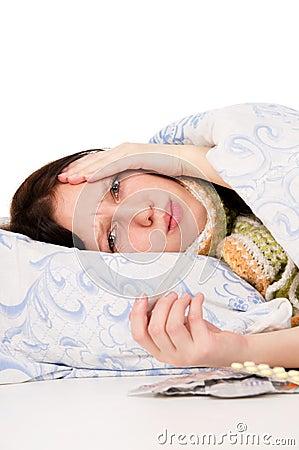 The diseased girl lying in bed, aching head