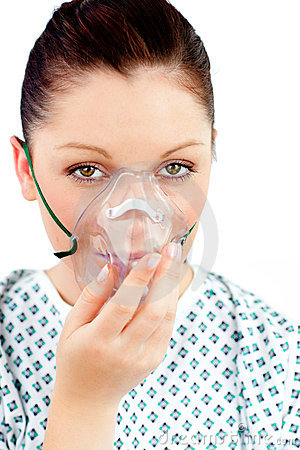 Diseased young woman with an oxygen mask