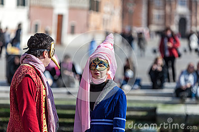 Disguised Couple in Venice Editorial Photo