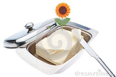 Dish of butter and table knife.