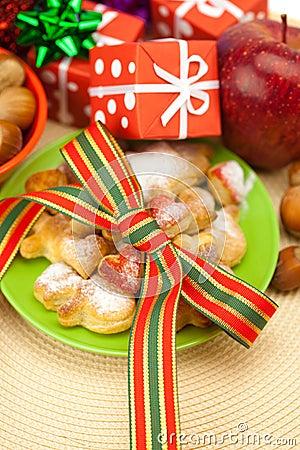 Dish, cookies, gifts and Christmas balls