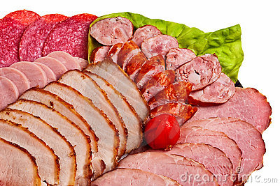 Dish with sliced ham, salami, sausage ...