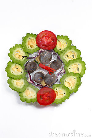 Dish of snail, bitter lemon, tomato and chilli