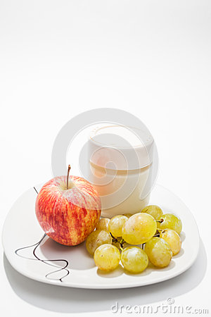 Dish with yogurt, apple and grapes