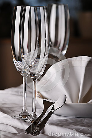 Dishware on the white tablecloth
