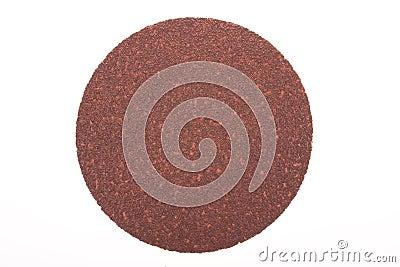 Disk of brown sandpaper
