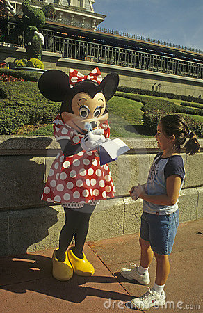 Disney World Magic Kingdom - Minnie Mouse and fan Editorial Photo