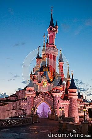Disneyland Paris Castle illuminated at sunset Editorial Stock Photo