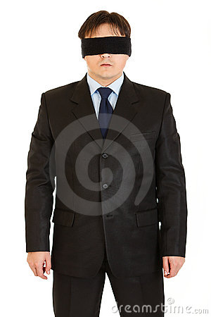 Disoriented businessman with blindfold on eyes