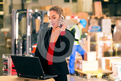 Dispatcher using phone at warehouse of forwarding