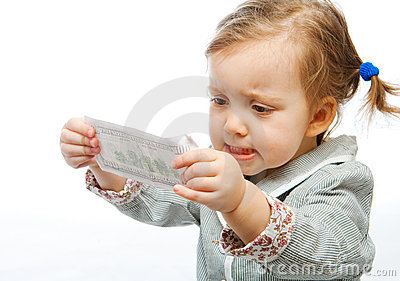 Displeased baby with banknote
