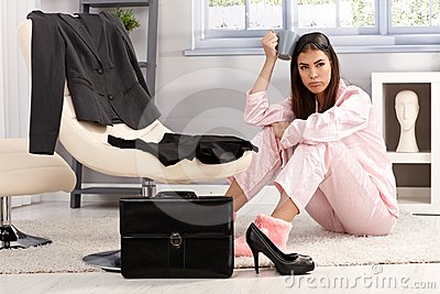 Displeased woman getting ready for business