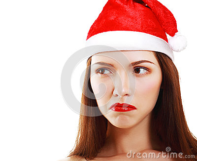 Dissatisfied girl in Santa s hat