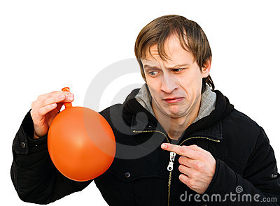 Dissatisfied young man hold a balloon
