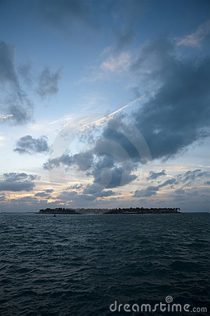 Distant island at sunset on Gulf of Mexico