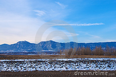 Distant Mountains, Snowbank and Trees