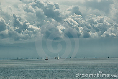 Distant sailboats on lake