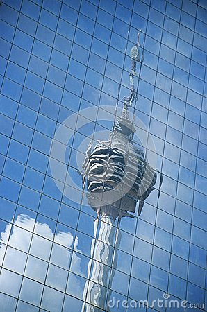 Distorted reflection of Kuala Lumpur Tower in building wall full frame