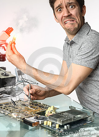 Free Distressed Tech Failing To Fix Faulty Motherboard Stock Photography - 65886782