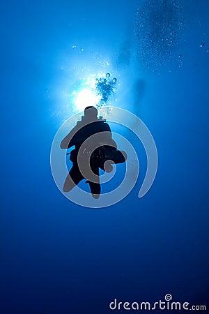 Diver descent in blue