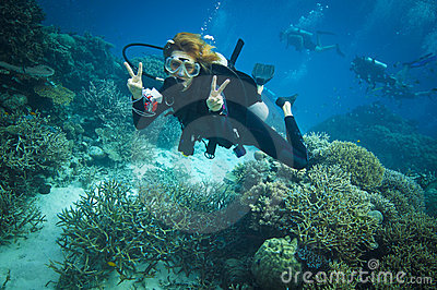 Diver flashing peace sign the Great barrier