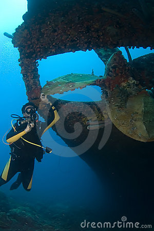 Diver with Propeller of wreck Hilma Bonaire