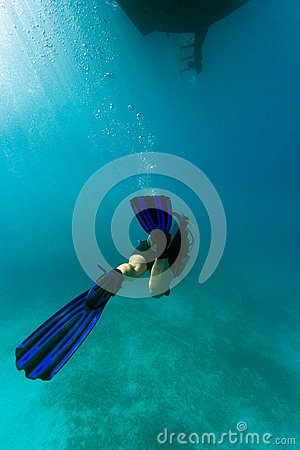 Diver under the boat