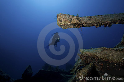 Diver underwater with ship